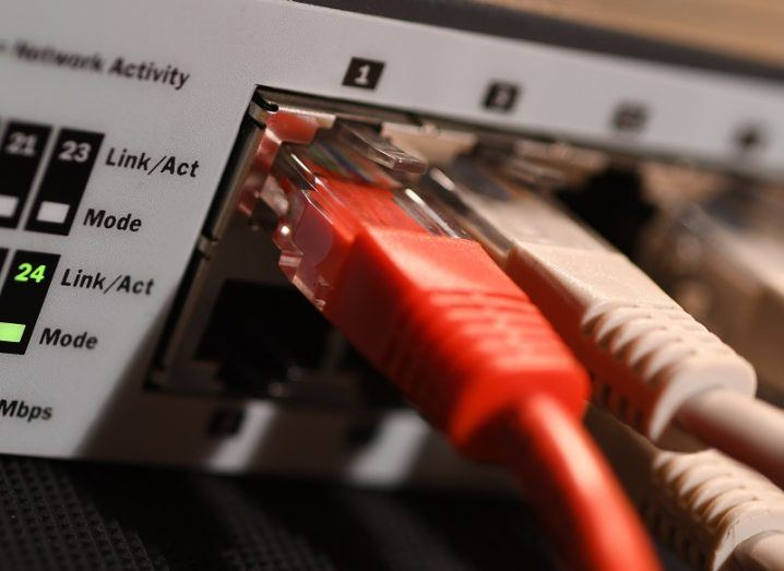 Close-up image of cables plugged into a router.