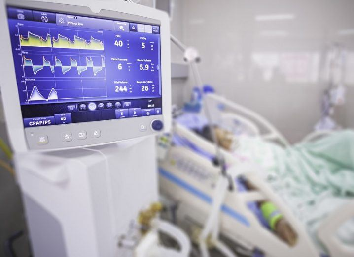 Ventilator machine and patient in a hospital bed.