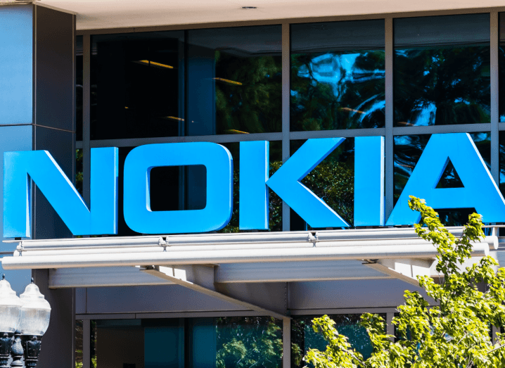 A large blue Nokia sign above a building on a sunny day.
