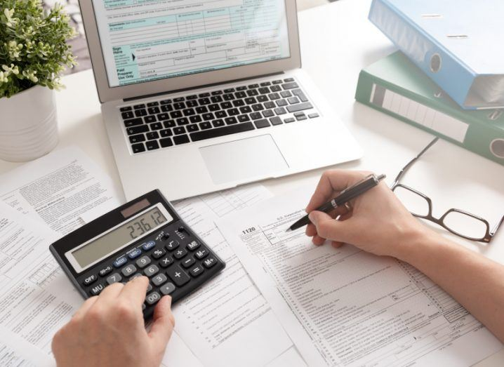 Accountant working with tax forms and annual returns.