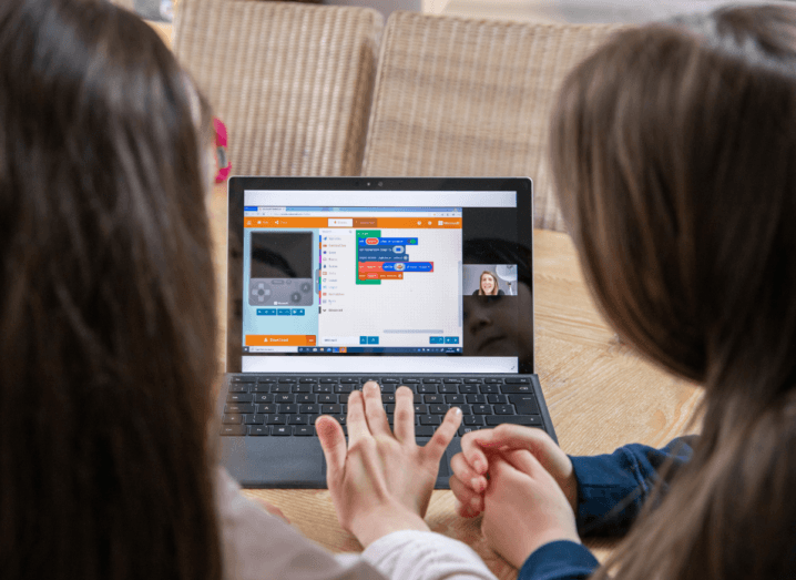 Two children using the DreamSpace platform on a Microsoft laptop.