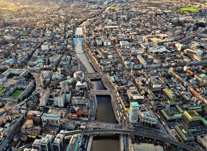 A bird's eye view over the city of Dublin, with the river Liffey running through the centre of the photograph.