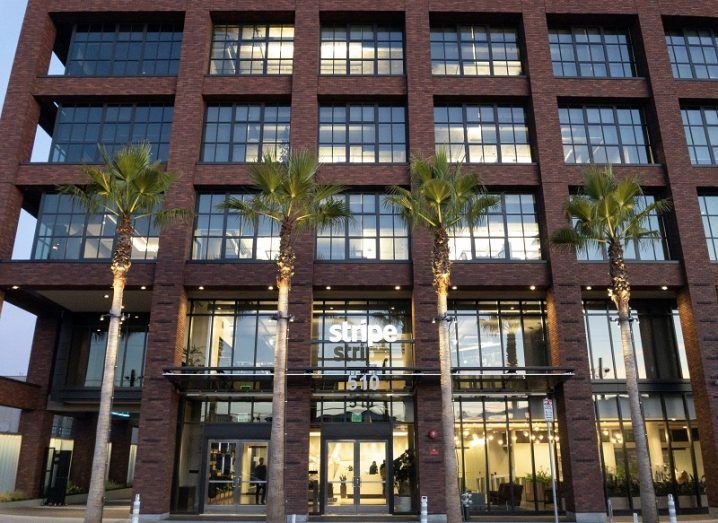 Exterior of Stripe's San Francisco headquarters with palm trees out the front.