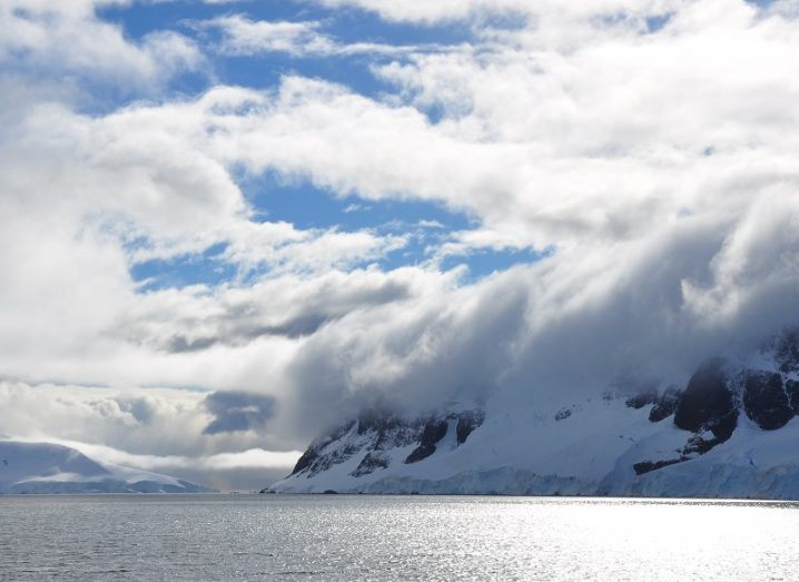 Clouds high above the coast of Antarctica as seen from the ocean.