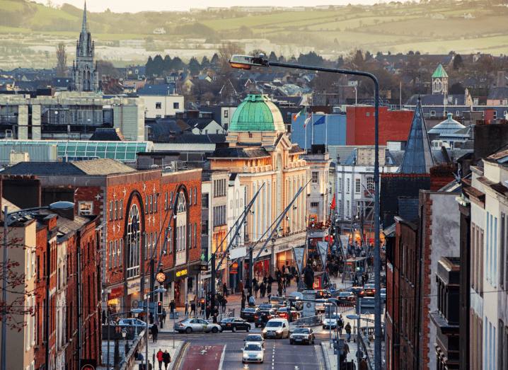 A view up Cork city's main street with the suburbs in the background and the countryside far off in the distance.