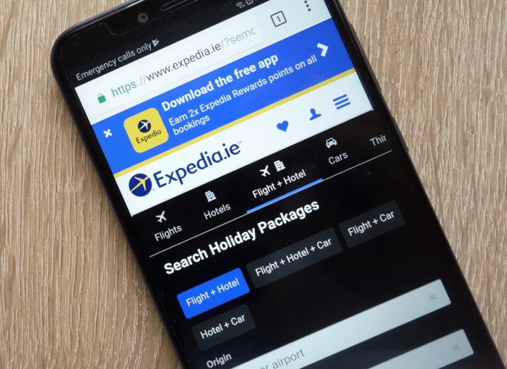 A mobile phone screen displaying the Expedia home page.