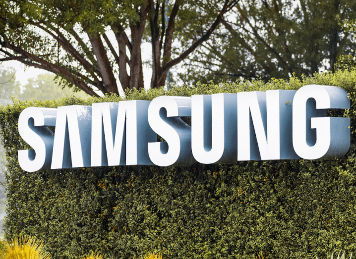The Samsung logo on the front of a hedge.