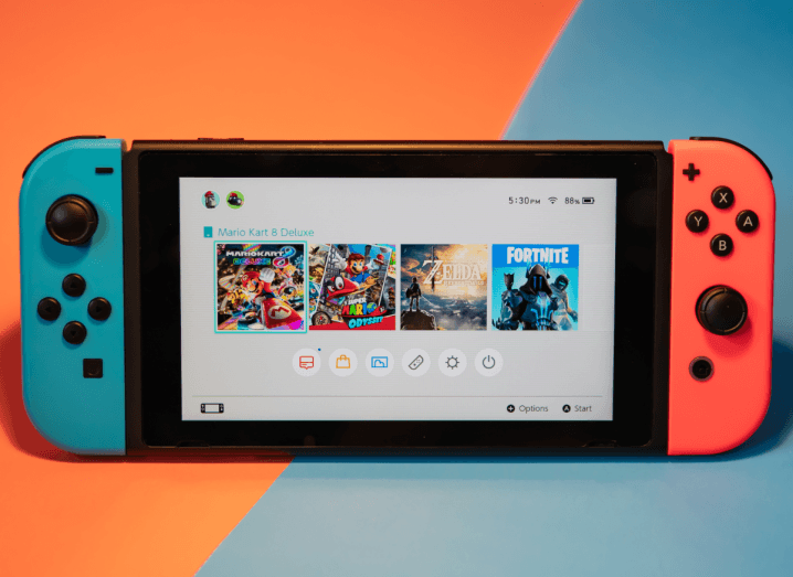 The Nintendo Switch console with the screen lit up showing the device's home screen.