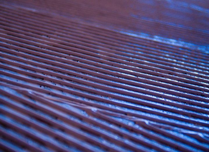 Metal sheets with grooves coloured blue.