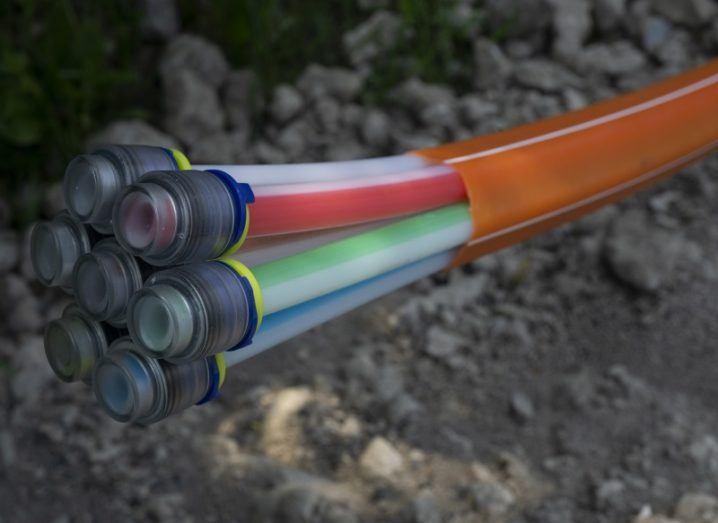 Close-up of a split fibre-optic cable coloured orange.