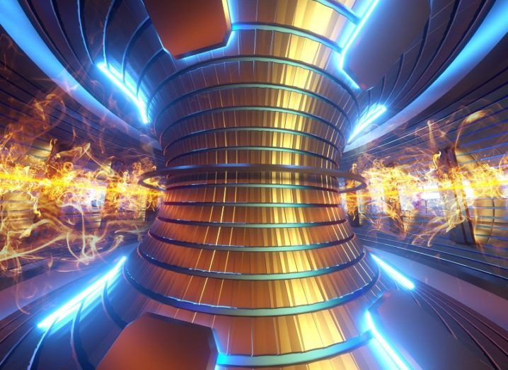 3D render of inside an active tokamak fusion reactor coloured gold, silver and blue.