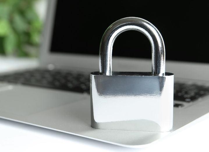 A silver padlock on a laptop.
