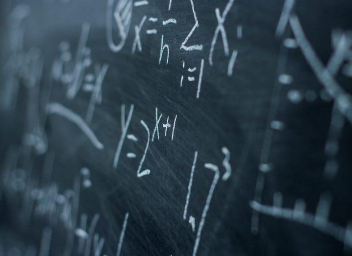 Maths formulae on a chalkboard.