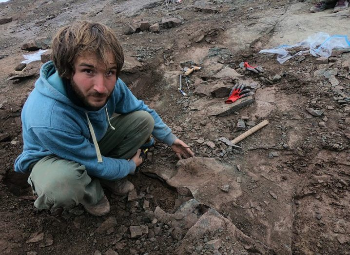 One of the researchers working at the remains of the newly discovered megaraptor species.