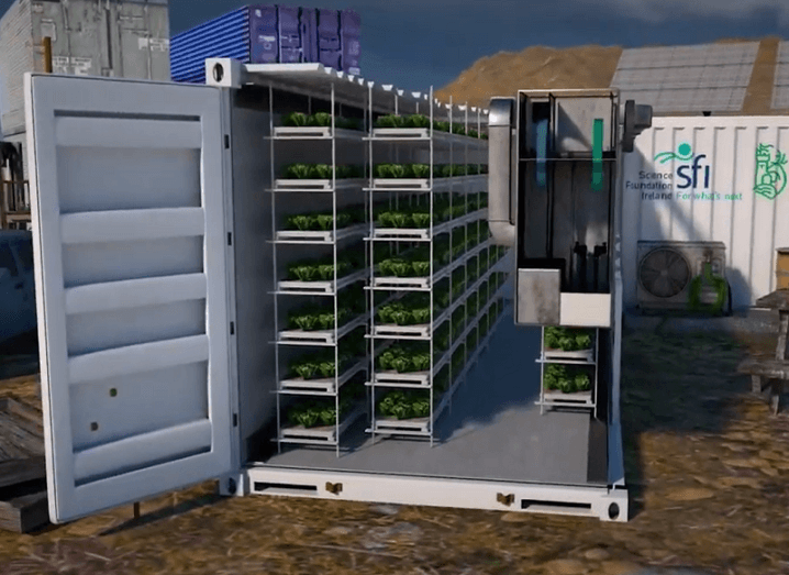 3D render of the eco-greenhouse concept with racks of crops in a container.