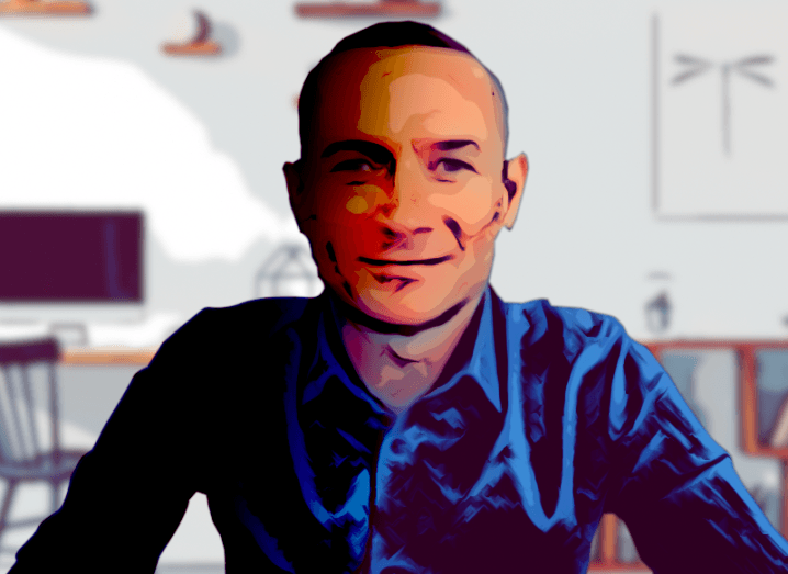 A digitally enhanced photo of Malcolm Barske from Avanade wearing a blue shirt against an office background.