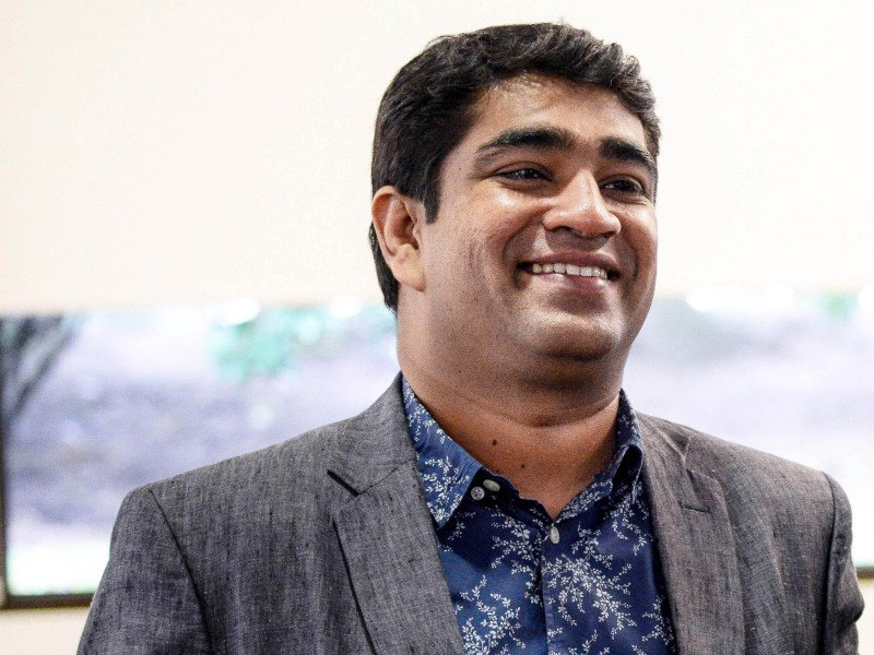 Image of Sanjoe Jose wearing a suit in a bright room.