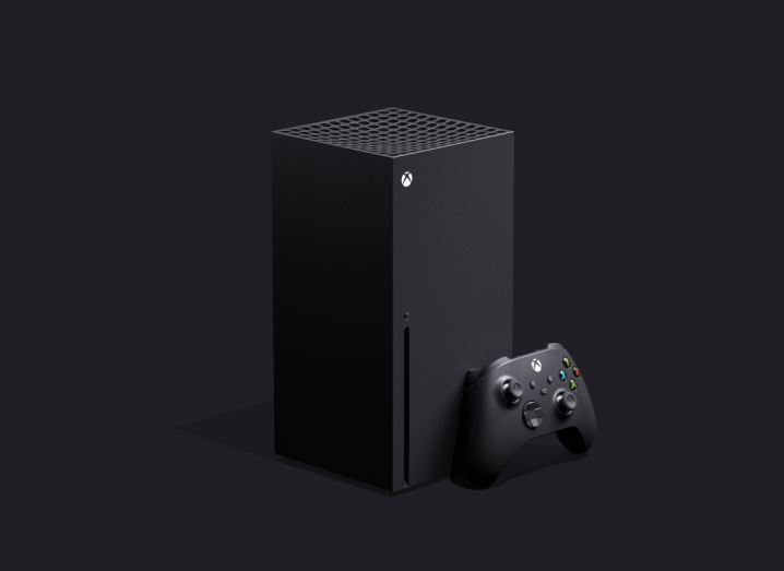 The black Xbox Series X console in front of a slate grey background.