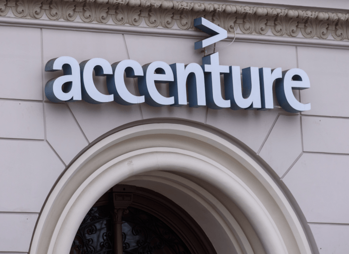 A beige brick building with the Accenture logo on the front of it.