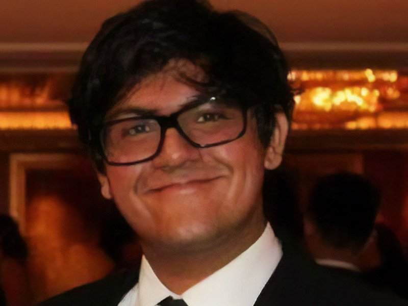 Karan Kanwar of Wing AI is smiling into the camera.