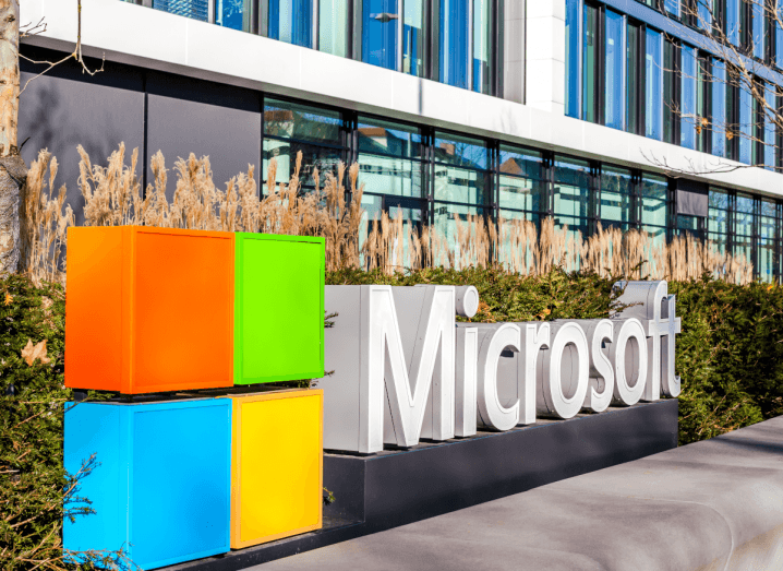 The Microsoft logo outside of an office building.