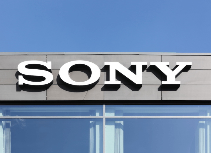 The Sony logo on the side of an office building under a blue sky.