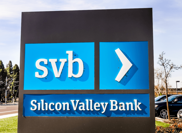 Silicon Valley Bank's logo printed on a blue background on a sign.