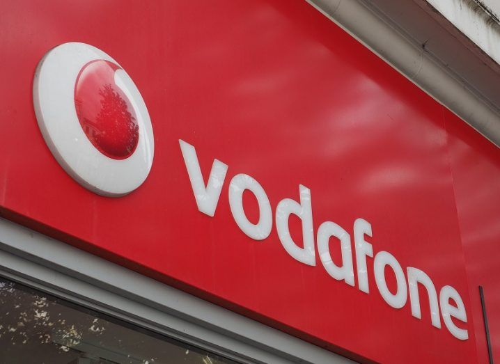 The Vodafone logo on a store front.