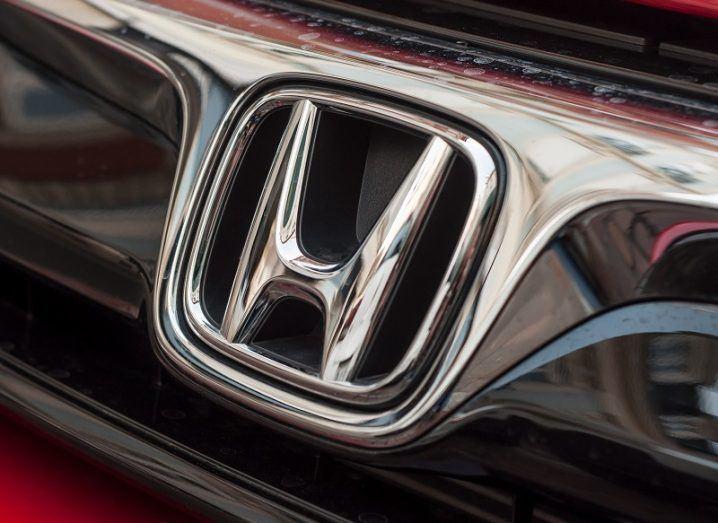Close-up of a Honda logo on a car.