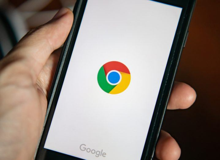 A close-up image of the Google Chrome app being opened on a smartphone.
