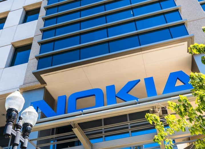 Looking up at the Nokia logo on the side of a tall, glass building.
