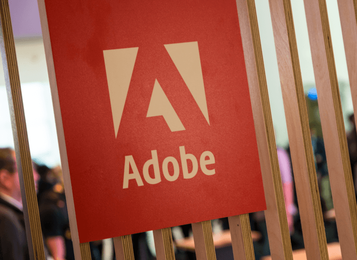 The Adobe logo displayed on a wooden panelled wall.