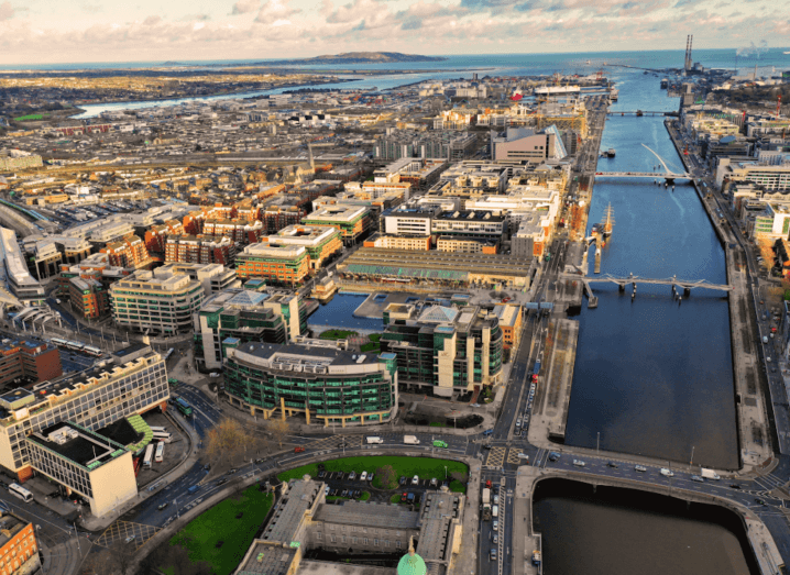 An aerial view of Dublin, with the city's financial services centre at the foreground of the image.