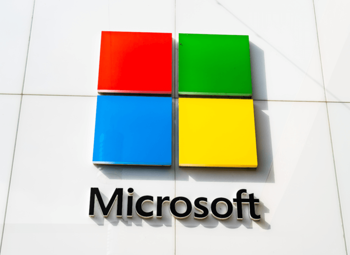 The Microsoft logo on the front of a white building.