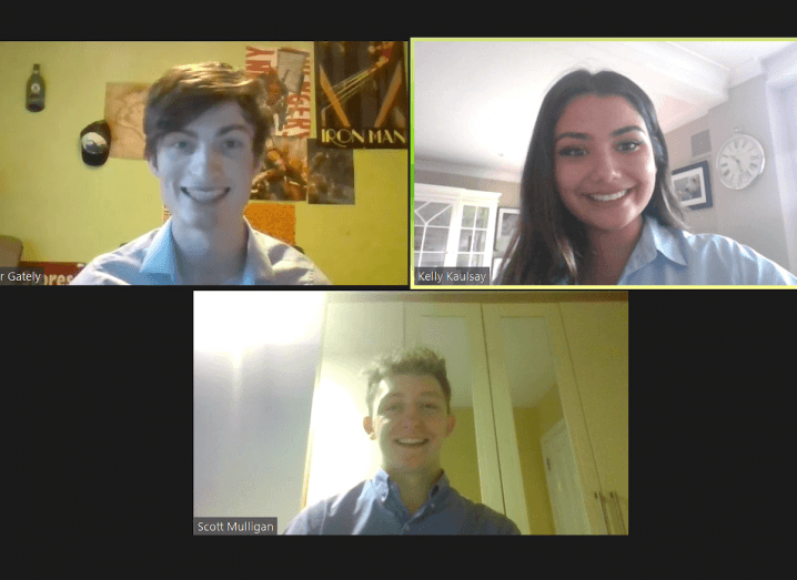 A young woman and two young men appear on a Zoom call.