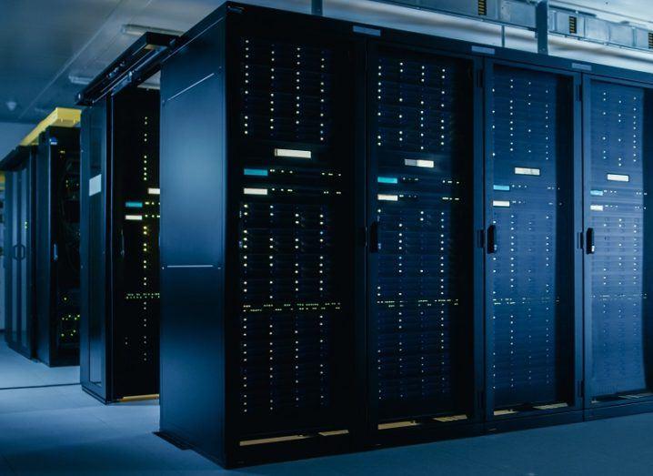 Data centre stacks in a dark server room.