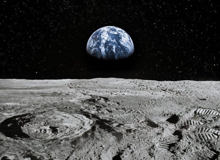 Render of the surface of the moon with the Earth visible in the distance.