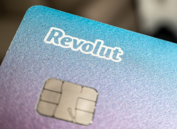 A close-up image of a blue and purple Revolut card.