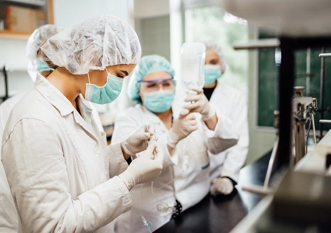 Researchers in a lab testing a potential vaccine candidate.