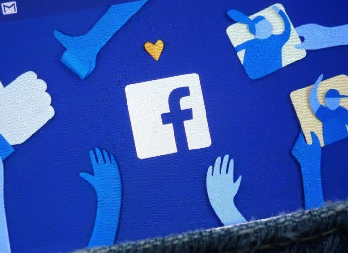 Facebook logo on a smartphone screen.