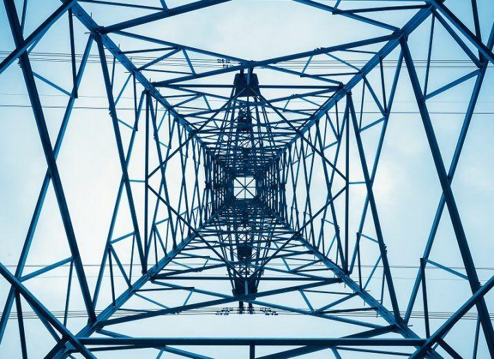 Upward view of an electricity pylon tower.