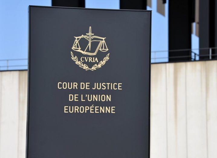 Logo of the Court of Justice of the EU on a sign outside a building.