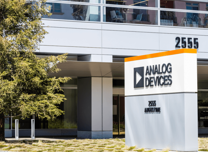 The Analog Devices logo on a pillar outside of an office building.