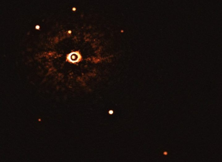 Image of the parent star and its two exoplanets in the bottom-right hand corner of the image.