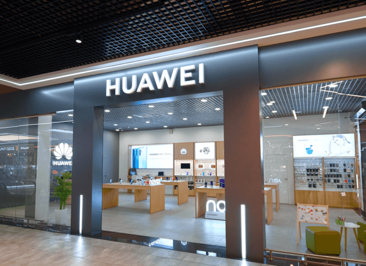 A Huawei storefront. Inside the shop there are tables with smartphones and other devices on display.