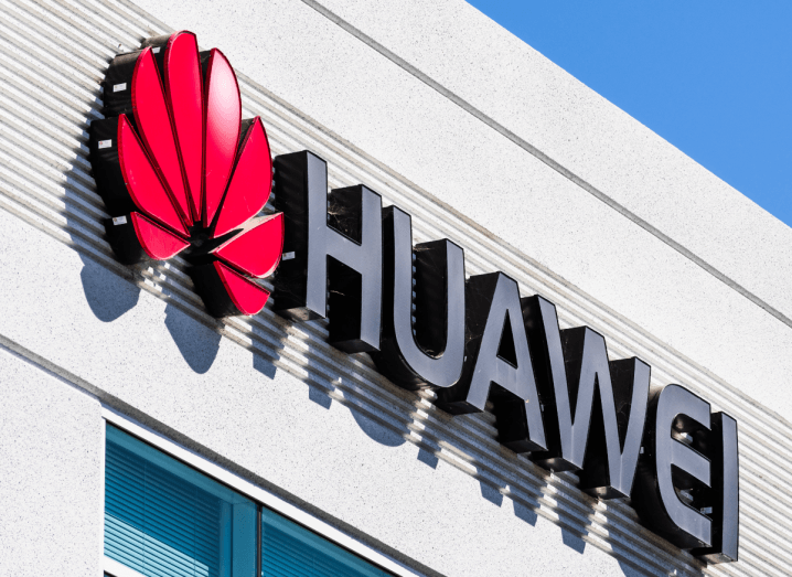 The Huawei logo on the front of a building.