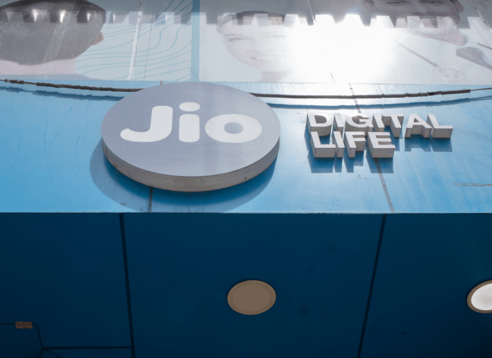 The Jio logo in a circle on a blue sign. The sign says 'digital life' in white text.