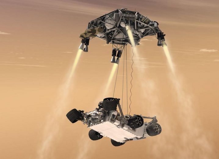 Illustration of the Perseverance rover touching down on Mars.
