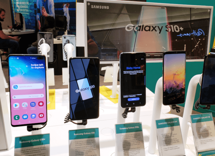 Samsung smartphones on display in a retail store.