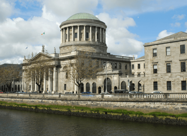 A court building in front of the Liffey river.